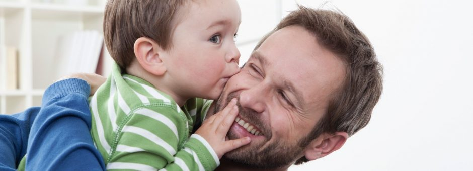 Germany, Bavaria, Munich, Son (2-3 Years) kissing his father, smiling